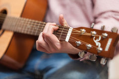 Men playing on classic wooden guitar Royalty Free Stock Image