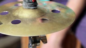 Men playing at cymbal from cajon Stock Photos
