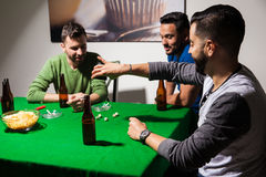 Men playing dice and drinking beer Royalty Free Stock Photography