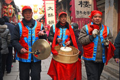 Men playing drum gong Chinese folk entertainment. Chinese folk entertainment activities performance during the Spring Festival on the traditional street in Stock Photo