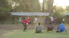 Men playing football in Ethiopia stock video