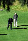 Men playing golf, Andalusia, Spain. Stock Images