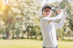 Men playing golf stock photos