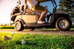Men playing golf Stock Images