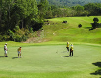 Men playing golf in Thailand Stock Image