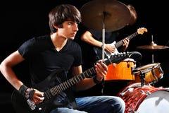 Men playing  guitar. Stock Image
