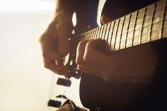 Men playing guitar close-up shot Stock Images