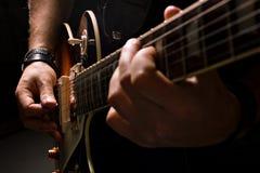 Men playing on guitar Stock Photos