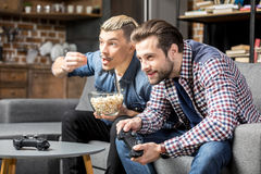 Men playing with joysticks Royalty Free Stock Photos