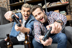 Men playing with joysticks Royalty Free Stock Photography