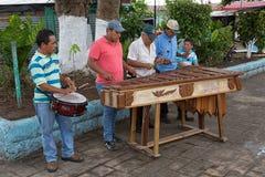 Men playing marimba music on the street of Flores Guatemala Royalty Free Stock Photography