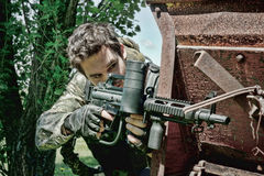 Men playing paintball stock images