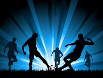 Men playing soccer. Silhouettes of a group of men playing soccer Stock Photos