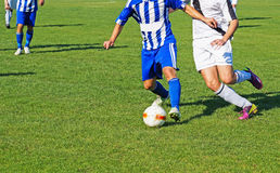 Men are playing soccer Royalty Free Stock Images