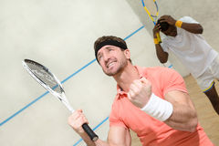 Men playing squash Stock Images