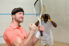Men playing squash Royalty Free Stock Images