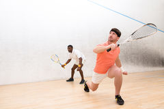 Men playing squash Royalty Free Stock Photos