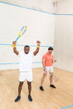 Men playing squash Stock Photos