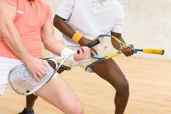 Men playing squash Royalty Free Stock Image