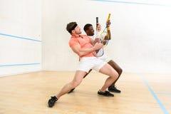 Men playing squash Royalty Free Stock Photos