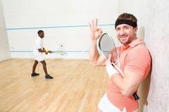 Men playing squash Royalty Free Stock Photo