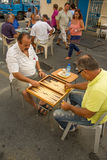 Men playing tavli (backgammon) Royalty Free Stock Images