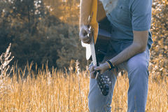 Men is playing on th guitar in nature Stock Images