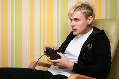 Men playing video game Stock Images