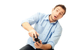 Men playing video games. Suprised student playing video games. Isolated on white background Stock Image