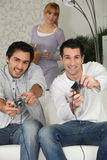 Men playing video games. Competetive men playing video games Stock Photography