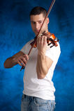 Men playing violin Stock Photo