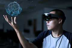 Men Playing Virtual Reality with  Hololens with effects. Enter the Virtual Reality world by Hololens. Close up to the face and computer Royalty Free Stock Image