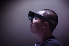 Men Playing Virtual Reality with Hololens with effects. Enter the Virtual Reality World with effect by Hololens computer Royalty Free Stock Image