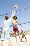 Men Playing Volleyball At Beach Royalty Free Stock Photos