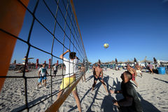 Men playing volleyball on the beach royalty free stock photos