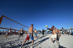Men playing volleyball on the beach Stock Photos
