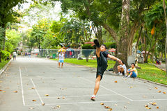 Men plays badminton using feet in Ho Chi Minh, Vietnam. Royalty Free Stock Image