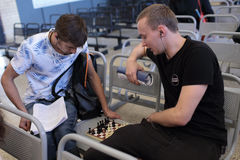 Men plays chess in a waiting hall Royalty Free Stock Photos