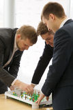 Men plays in football table game Royalty Free Stock Photos