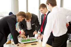 Men plays in football table game Royalty Free Stock Image