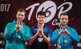 Men Podium for Paris 2014. Men Podium with winner Dimitrij Ovtcharov, Shibaev Alexander runner up and Simon Gauzy third place at the ITTF Europe Cup 2017. 3-5/02 Royalty Free Stock Image