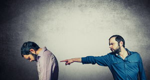 Men pointing on each other. Two man pointing on each other Royalty Free Stock Photography