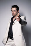 Men Pointing At You. Portrait of a young confident man pointing at you  over white Royalty Free Stock Images