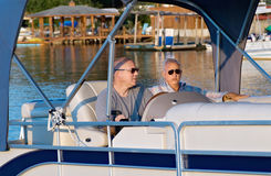 Men pontoon boat stock image
