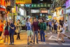 Men posing at a road in Hong Kong at dark Royalty Free Stock Image