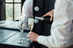 Men pour champagne into glasses. From wine bottles. To celebrate a successful deal Stock Images