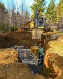 Men pouring concrete foundation Stock Image