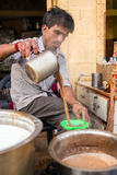 Men pours cup hot milk tea Indian style Royalty Free Stock Photography