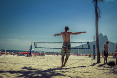 Men practices slacklining at Ipanema Beach in Rio de Janeiro Stock Photo