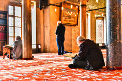 Men praying in Sultan Ahmed Mosque or Blue Mosque in Istanbul Royalty Free Stock Photo